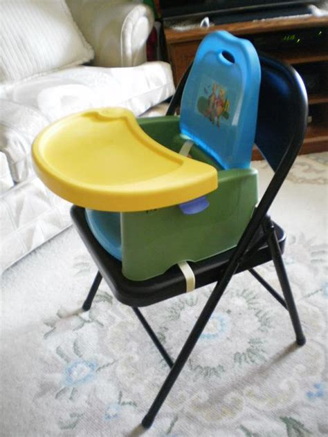 the first years swing tray booster seat unisex quot winnie the pooh quot first years swing tray booster