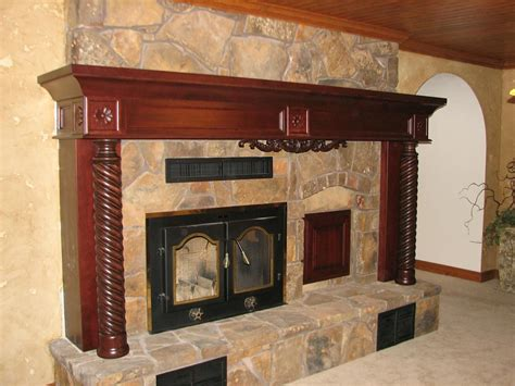 made cherry fireplace mantel with carved details