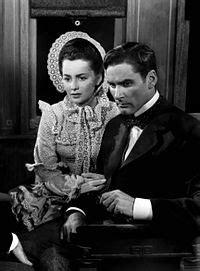 With Olivia de Havilland in Santa Fe Trail (1940)