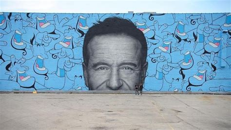 talented artists create  giant robin williams mural