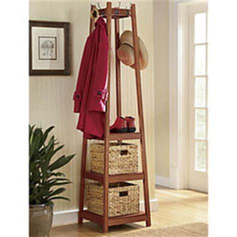 Coat Rack Storage by Coat Rack With Storage Baskets Findgift