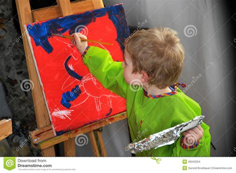 free painting for 4 year olds painting boy stock photo image 49342254