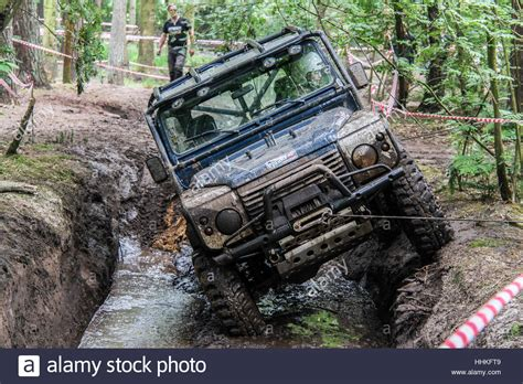 Stiker Mobil Defender 90 Pernik Offroad 4x4 blue 4x4 land rover defender 90 during muddy 4x4 road challenge stock photo royalty free