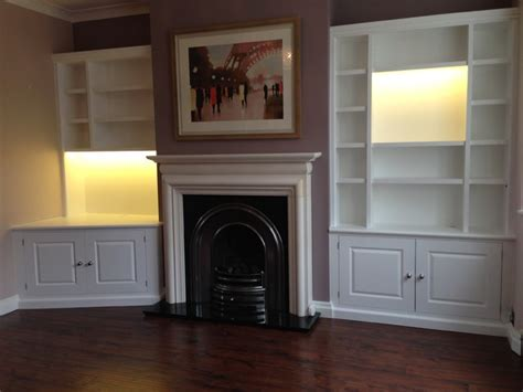 White painted alcove shelving units with lighting