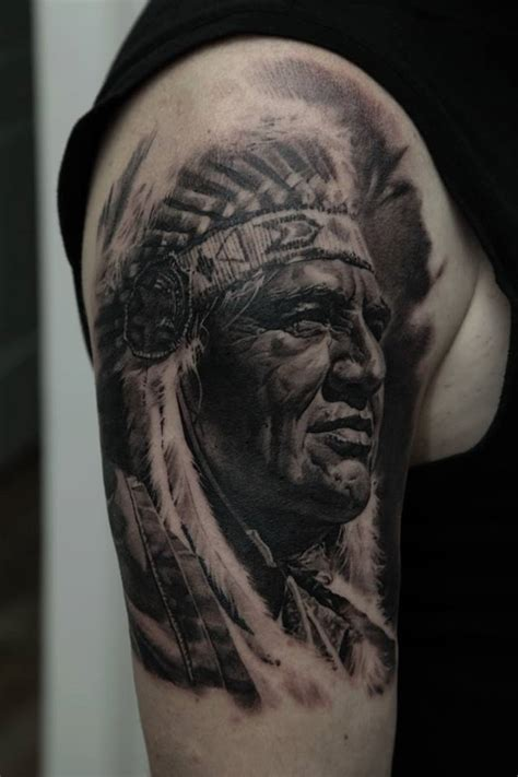 tattoo face with printer ink black ink native man face tattoo on right half sleeve
