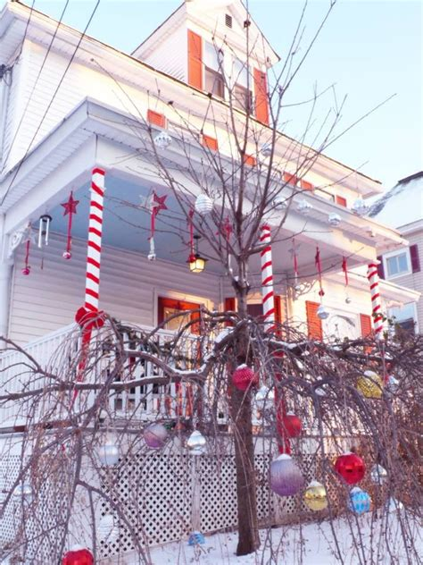 outdoor candycane ribbon porch decoration this year porch columns silver bells hung from
