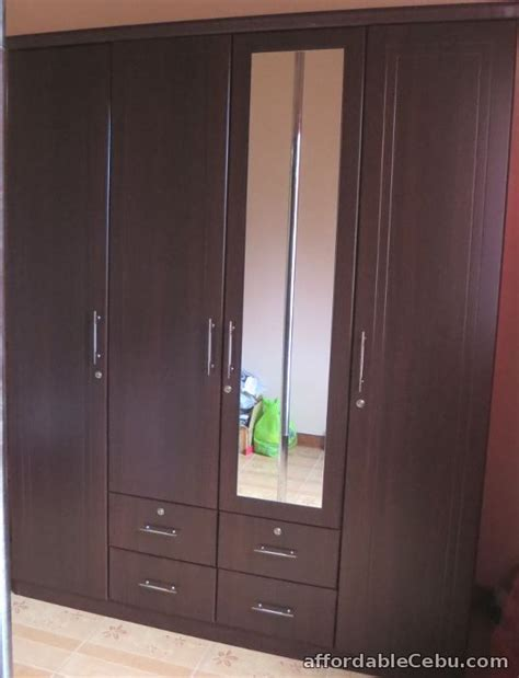 Wardrobe cabinet, four doors, drawers and mirror For Sale