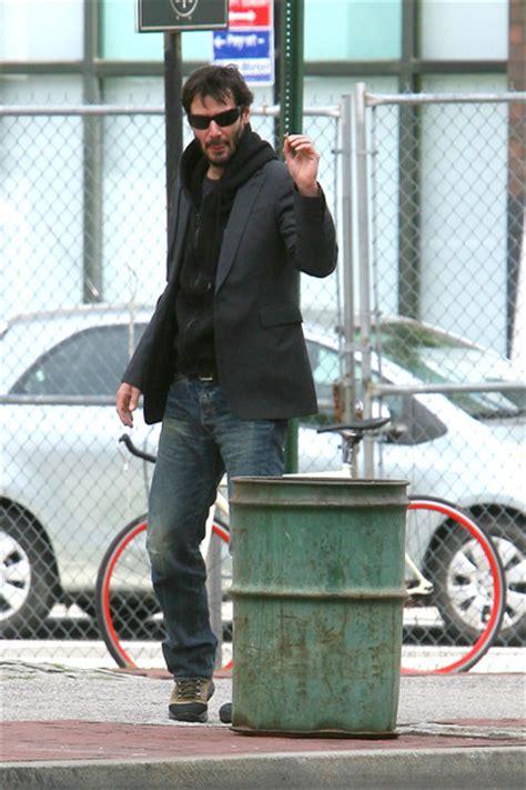 keanu reeves park bench keanu reeves photos photos keanu reeves drinks coffee in