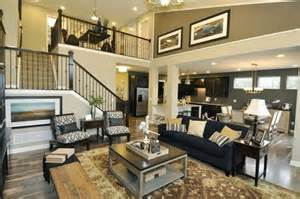 open great room floor plans a graceful open staircase frames the two story great room