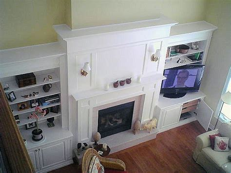 white lacquer wall unit fireplace mantel tv enclosure