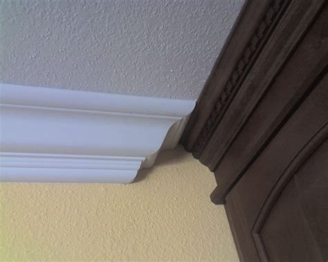 Examples Of Painted Kitchen Cabinets joining 2 different crown moldings finish carpentry