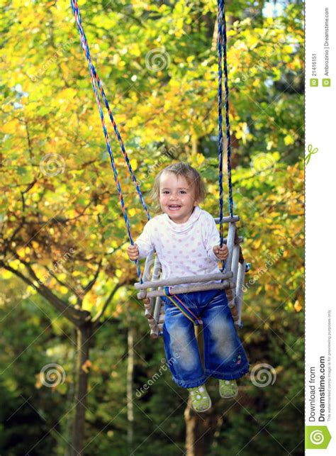 is swinging fun fun on a swing stock image image 21416151