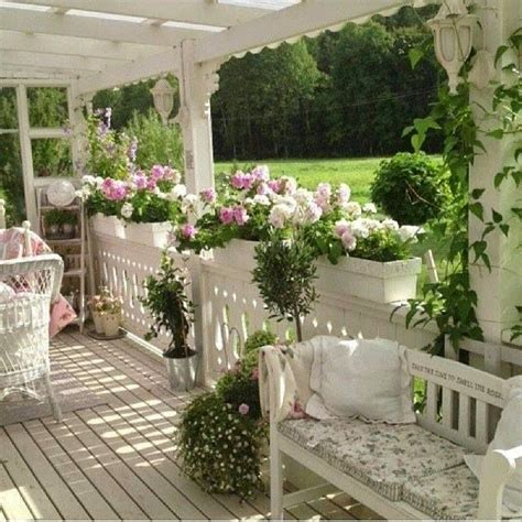 shabby chic front porch with beautiful flowers porches