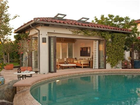 mediterranean house plans with pool a mediterranean style pool house covered with ivy creates