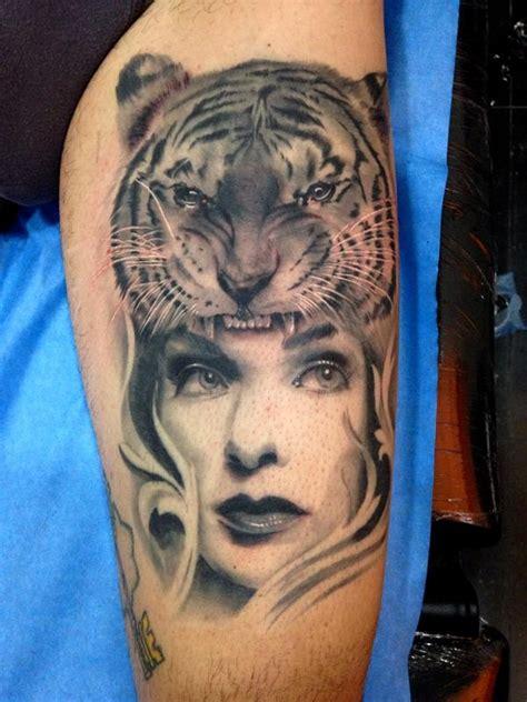 M U R A H Gir Gendong Tiger tattoos jose gonzalez tiger and realistic black