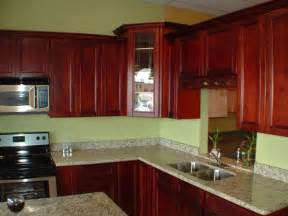 look how much more toned down these cherry cabinets against the kitchen island over small white pendant and corner