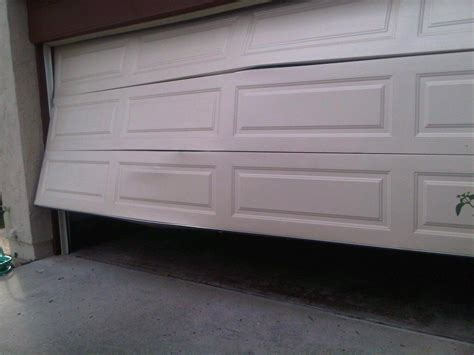 Fixing Garage Doors How To Fix A Dent In Your Garage Door Doormatic Garage Doors