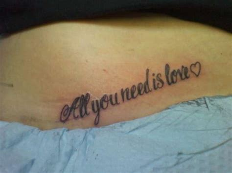 tattoo love is all all you need is love tattoo