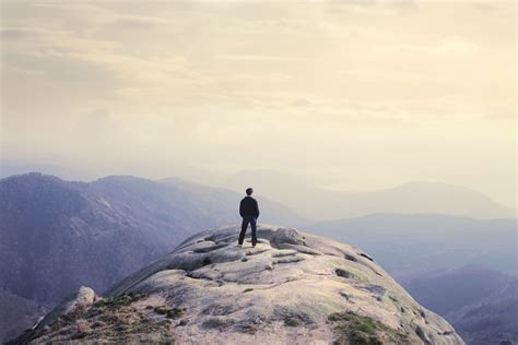 man standing on mountain top a letter to the second semester freshman
