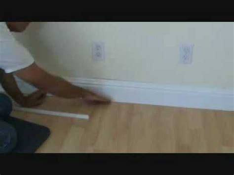 how to install a hardwood floor without removing the existing baseboard