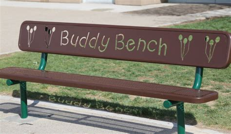 the buddy bench playground bench helps na kids make friends