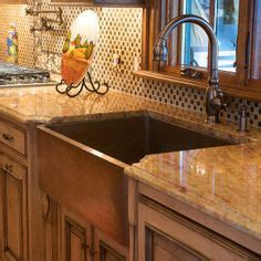 copper sink with stainless steel appliances copper sink copper accented backsplash countertops