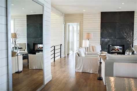 floor mirror in living room big mirror on the floor and white horizontal siding in the