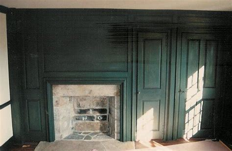 paneled fireplace wall  antique milk paint finish