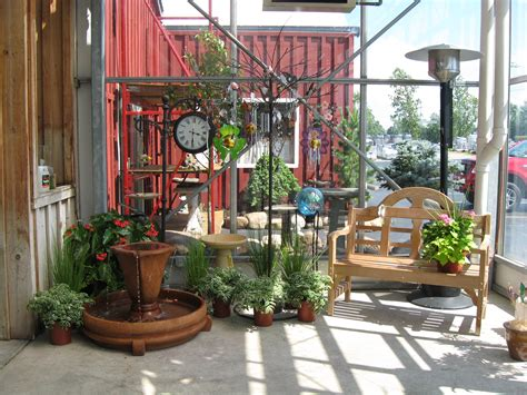 Whimsical Garden Decor Whimsical Garden Well With Tires This Cascade Of Color And G Wooden Hummingbird Feeder Donnas