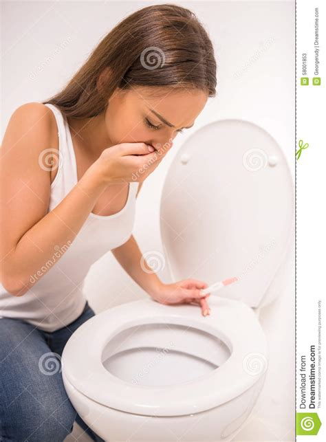 bathroom problems while pregnant woman in toilet stock photo image 58001853
