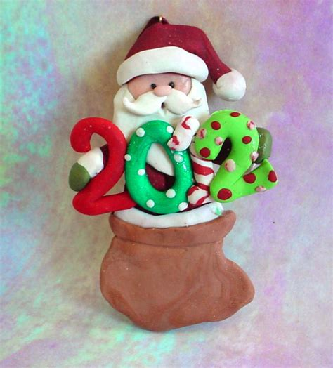 polymer clay 2012 christmas ornament by alongcameaspider1