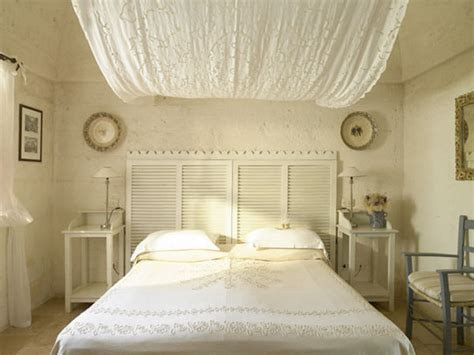 old shutters for headboard 8 creative ways to use old shutters