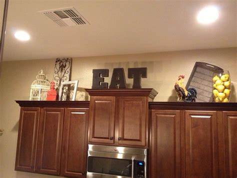 Kitchen Cabinet Decals by 25 Best Ideas About Above Cabinet Decor On