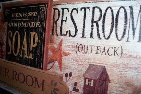 Bathroom Plaque by Primitive Bathroom Wall Decor Plaque Restrooms Outback