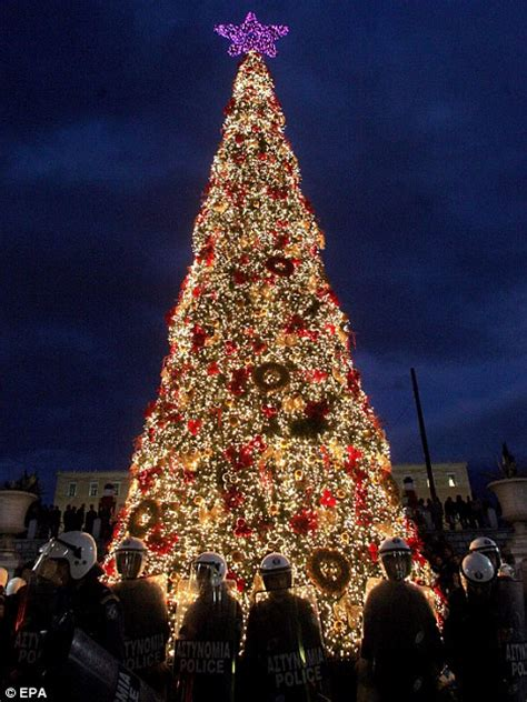 riot police forced to guard christmas tree in athens after