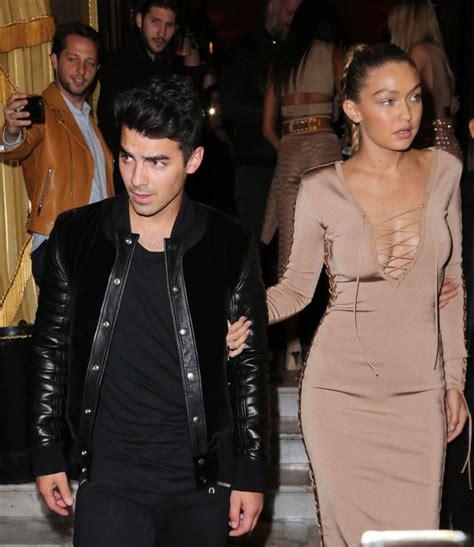 gigi hadid s boyfriend joe jonas photos pics gigi hadid displays eyeful of cleavage as boyfriend joe