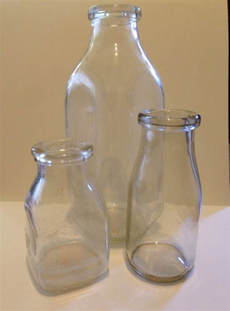 vintage glass milk bottles by puddles n boots