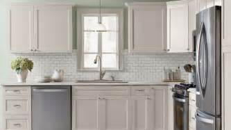 kitchen with antique white shaker style cabinets crown