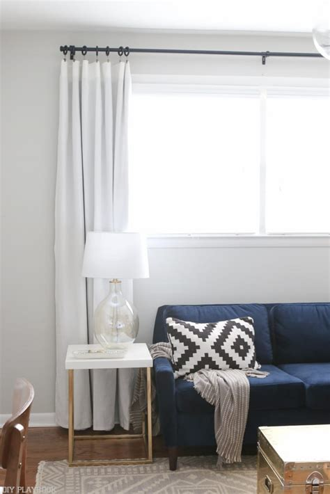 How To Curtains For Bedroom by How To Hang Curtains High And Wide To Make Your Window