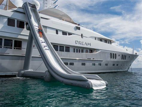 big boat with slide 7 epic inflatable water slides for the super rich that you