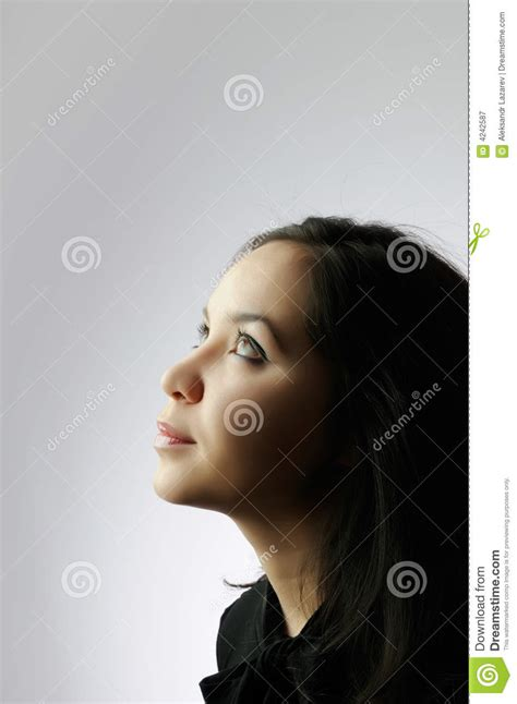 beautiful woman by the tree looking up stock photo image young beautiful girl looking up royalty free stock