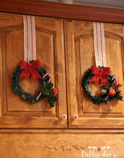 christmas bows on kitchen cabinets dollar store christmas wreaths in the kitchen debbiedoos