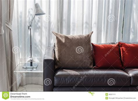 brown sofa with red cushions brown and red pillow on sofa with l stock photo image