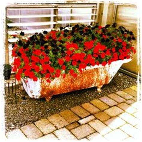 bathtub flower bed bathtub flower beds on pinterest bathtubs planters and tubs