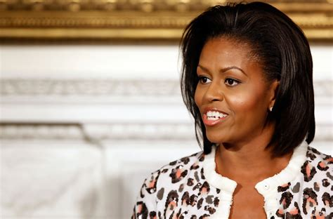 ms obamas hair new cut michelle obama medium layered cut michelle obama hair