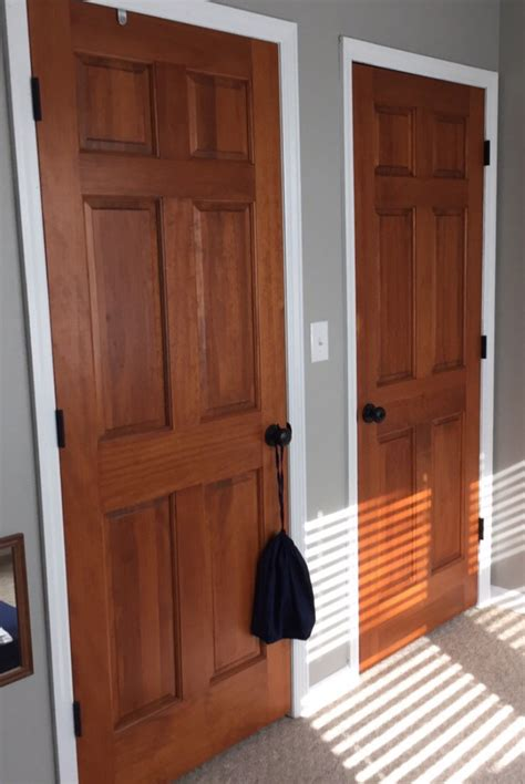White Interior Doors With Stained Wood Trim Wood Stained Doors Aged Bronze Door Knobs White Trim Woodlawn Colonial Paint From Valspar