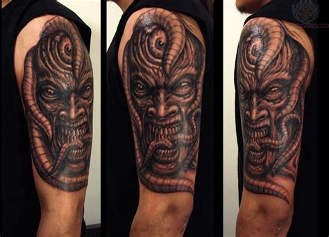 half sleeve biomechanical demon tattoo design