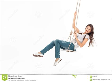 free online swinging young woman swinging royalty free stock photography