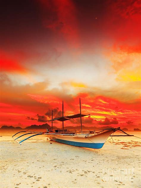 boat from malaysia to indonesia traditional philippine boat bangka at sunset