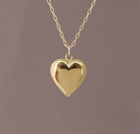 small gold locket necklace also in silver and gold